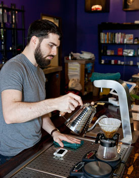Comet Coffee employee Daniel making a pour-over