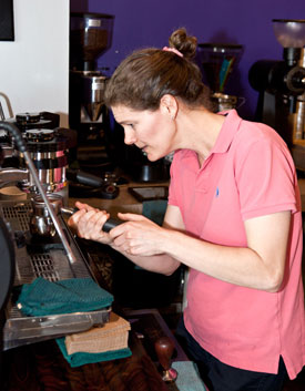 Comet Coffee employee Gretchen making a latte