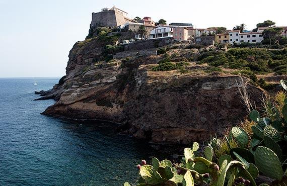 Capraia Isola village on the seaside cliff