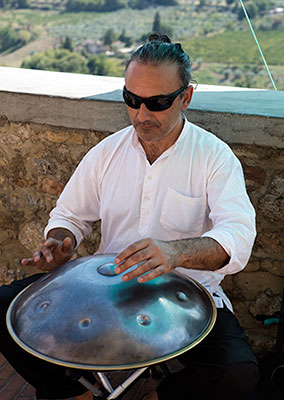 Amayur playing the PanART Hang drum in San Gimignano, Italy