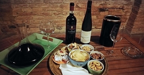 Brunello wine and snack tray at Casa Bolsinina in Tuscany, Italy