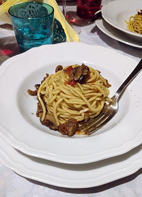 Spaghetti with mushrooms and sausage at Cook Eat Italian cooking class in Florence